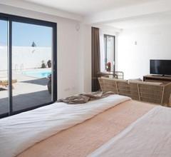 Edem III apartamento de diseño piscina climatizada by Lightbooking 1