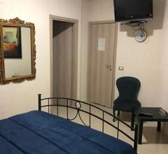 Oplonti Rooms 2