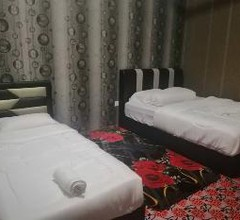 SPOT ON 89832 Famili Inn Ombak Rindu 2