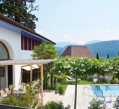 Luxusvilla im Weindorf Kaltern am See mit Infinity Pool, Sauna, Weinkeller und großem Garten zur Alleinnutzung 1