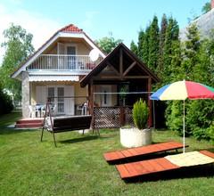 Ferienhaus mit Grillmöglichkeit und Gartenmöbeln 2