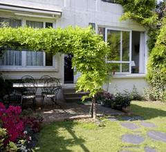 Ein charmantes Gästehaus in einem Garten, 500 m von Paris entfernt 2