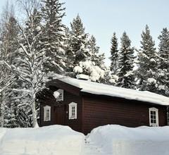 Uriges Ferienhaus in den Wäldern Lapplands am Fluss gelegen 1