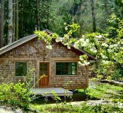 Forest Garden Cottage durch den Ozean 1