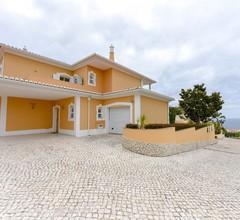 Eine 3-Bett-Villa mit herrlichem Blick auf Luz Bay in einem geschlossenen Condominium 1
